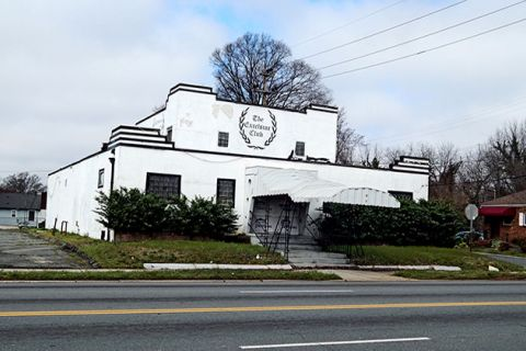 Excelsior Club in Charlotte. White dilapidated building.