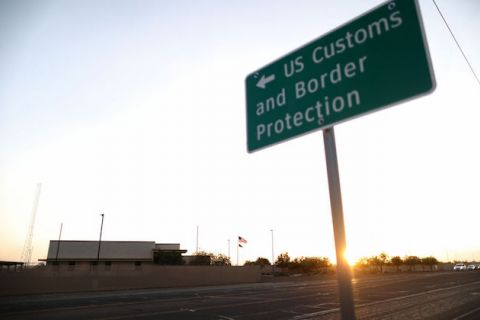 A green and white U.S. Customs and Border Protection (CBP) sign is posted outside the U.S. Border Patrol station