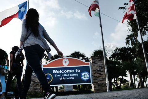A red, white and blue sign welcomes people to the U.S. from Mexico in Brownsville, Texas, on June 25, 2018.