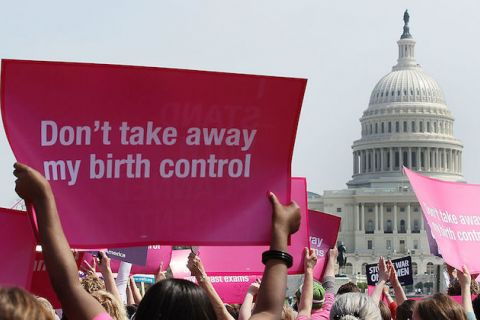 protest signs at a reproductive rights rally at Capitol Hill