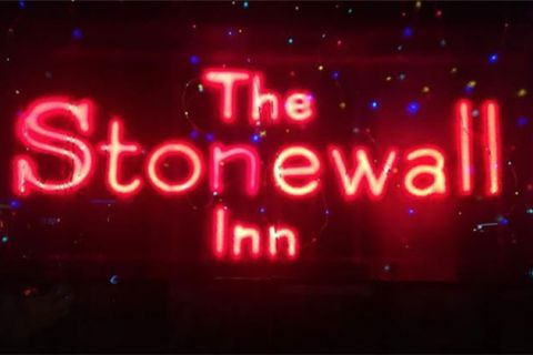 "Stonewall Inn. Neon red signage reads ""The Stonewall Inn."""