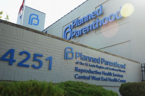 Exterior of Planned Parenthood of St. Louis. Gray-painted bricks, blue signage.