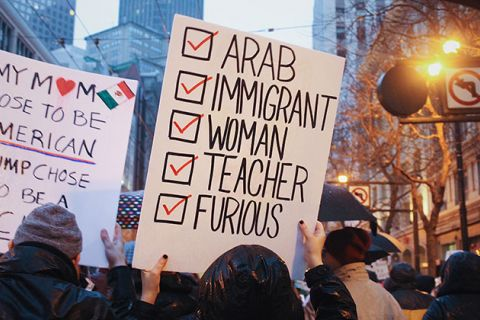 "Protest sign that reads, ""Arab, Immigrant, Woman, Teacher, Furious."""