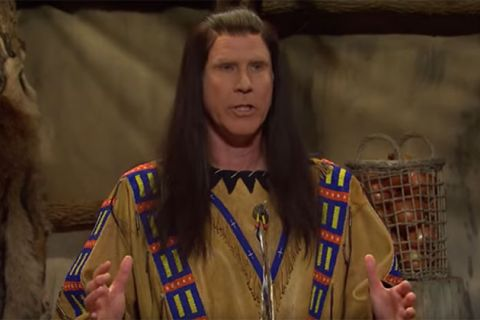 Will Ferrell. White man dressed as a Native American sitting at a dinner table.