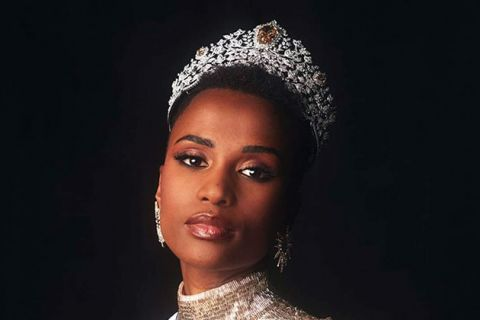 Zozibini Tunzi. Black woman with short dark hair wearing a crown.