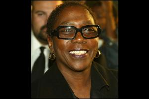 Afeni Shakur with black glasses and shirt