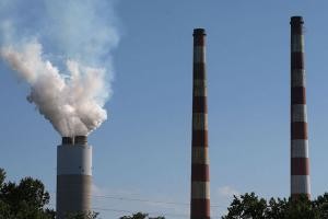 Emissions spew out of a large stack at the coal-fired Morgantown Generating Station June 29, 2015, in Newburg, Maryland.