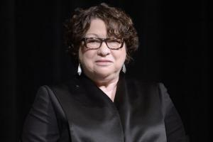 Justice Sonia Sotomayor in Black robes, black background