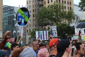 crowd with signs at Bernie Sanders action