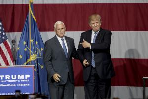 Mike Pence and Donald Trump shake hands on stage