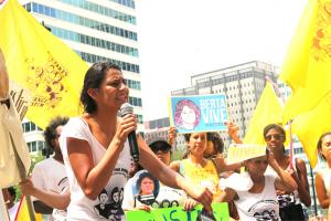 Laura Zuniga Cáceres, daughter of slain Indigenous land defender Berta Cáceres, speaking at #JusticeForBerta Action at the Democratic National Convention in Philadelphia on July 25, 2016, as part of It Takes Roots People's Caravan.