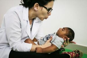 Dr. Stella Guerra performs physical therapy on an infant born with microcephaly at Altino Ventura Foundation on June 2, 2016, in Recife, Brazil. Microcephaly is a birth defect linked to the Zika virus where infants are born with abnormally small heads.