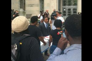 Color of Change Executive Director Rashad Robinson delivers the 500,000 petitions to the Department of Justice on Aug. 3, 2016.