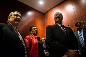 Current Congressional Black Caucus Chairman Rep. G.K. Butterfield, former Chairman Rep. Marcia Fudge, and Caucus Board Chairman Rep. Chaka Fattah, stand in line before the Congressional Black Caucus swearing-in ceremony on January 6, 2016.
