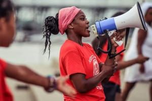 Crystal Williams rallying days after Alton Sterling's murder in Baton Rouge, Louisiana, at a candlelight vigil held in honor of the LGBTQ victims and victims of gun violence in her community on July 10, 2016.