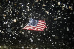 A U.S. flag is bent by the wind as the eye of Hurricane Hermine passes overhead in the early morning hours on September 2, 2016, in Shell Point Beach, Florida. Hurricane warnings have been issued for parts of Florida's Gulf Coast as Hermine makes landfall