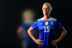 Megan Rapinoe in blue and white jersey with black/charcoal background