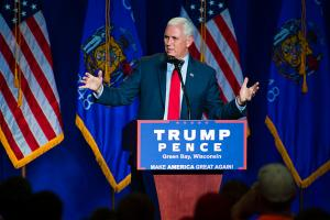 Republican vice presidential candidate, Indiana Gov. Mike Pence, greets a crowd before introducing Republican presidential candidate Donald Trump at a rally on August 5, 2016, in Green Bay, Wisconsin.