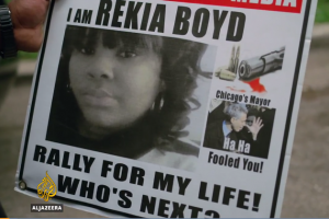 "Sign with photo of Rekia Boyd, text says, ""I am Rekia Boyd. Rally for my life! Who's next?"""