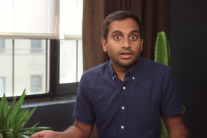 Aziz Ansari wearing a navy button-down shirt