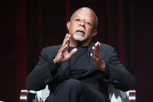 Henry Louis Gates Jr. in a black suit on a stage