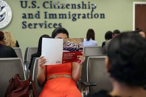 A Colombian immigrant studies ahead of her citizenship exam at the U.S. Citizenship and Immigration Services (USCIS) Queens office on May 30, 2013, in the Long Island City neighborhood of the Queens borough of New York City.
