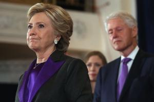Hillary and Bill Clinton, wearing black and purple
