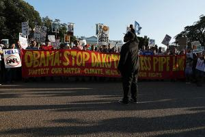 Activists gather in front of the White House during a rally against the Dakota Access Pipeline September 13, 2016, in Washington, D.C. Activists held a rally to call on President Barack Obama to stop the Dakota Access Pipeline.