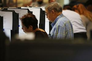 Voters cast their votes at an early voting center setup for the general election on October 31, 2016, in Miami, Florida. In the state, the share of Latinx early voters increased by about 4 percent from early voting during the 2012 election.