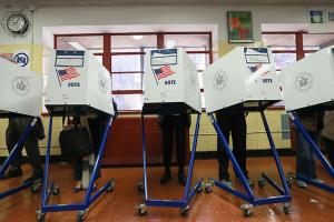 Voters cast their ballots at voting booths at PS198M The Straus School on November 8, 2016, in New York, United States.