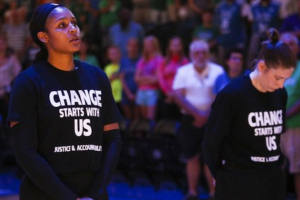 Maya Moore and Lindsay Whalen in black t-shirts with white lettering