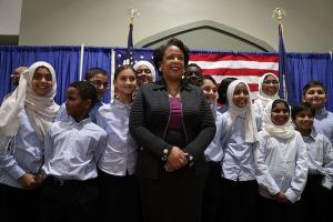Black woman with Muslim children