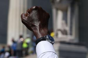 Black man with fist raised in air
