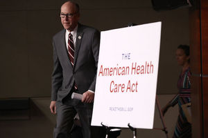 "Sign reads ""American Health Care Act"""