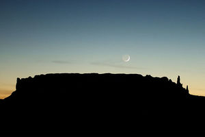 The moon sets over sandstone formations near Round Rock December 5, 2002, on the Navajo Indian Reservation, Arizona. A third of the nation lacks access to running water.