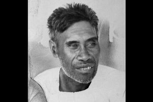 Greyscale image of Native Hawaiian man with white shirt and grey hair