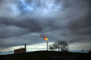 Natural gas is flared off at a plant outside of the town of Cuero, Texas, on March 26, 2015. The Bureau of Land Management has postponed regulations on these methane-emitting flares.