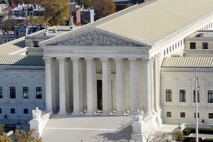 "White building with columns, pointed roof and steps and ""EQUAL JUSTICE UNDER LAW"" engraved at top"