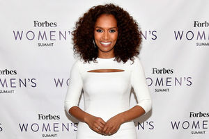 Janet Mock in a white dress