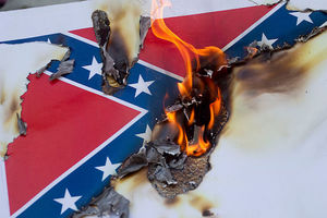 Red flag with navy blue crossed bars with white stars on white poster burned by orange flames into grey ashes