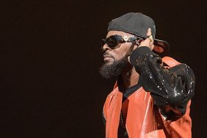 R. Kelly dressed in red leather and black sequins