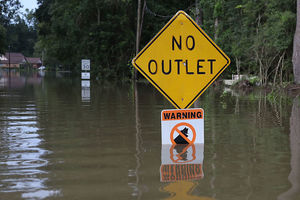 A sign is seen along the flooded road on August 15, 2016 in Baton Rouge, Louisiana.