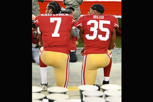 Colin Kaepernick. Two Black men in red jerseys with white lettering ... 8af22995f