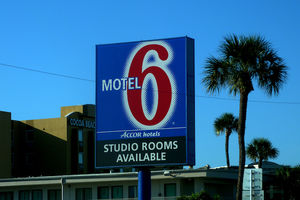Motel 6 sign against blue sky