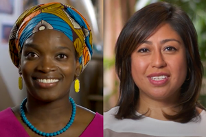 Black woman in pink shirt and blue necklace and yellow earrings and multicolored head wrap; Brown woman in shirt with grey and brown and yellow stripes
