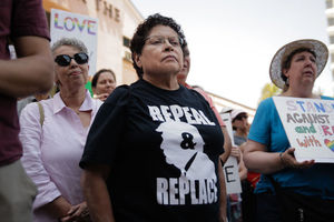 A woman wears a shirt advocating for the impeachment of President Donald Trump