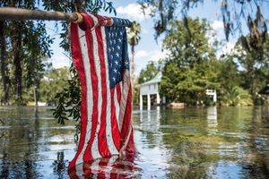 American flag in flood water