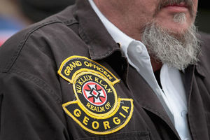 "White man wears patch on jacket that reads, ""Grand officer, Ku Klux Klan, Realm of Georgia."""