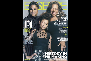 Two Black women in black dresses stand behind Black girl in black dress in front of light blue background on magazine cover with yellow and white text