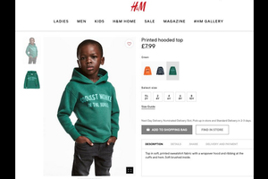 Black boy in green hoodie with light green text stands against white background in inset from website with white background and red and black text